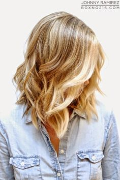 "A natural looking beige blonde base with bright buttery blonde highlights and a piecey long bob with minimal long layers that help create that ""lived in"" look."