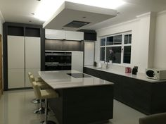 Dark Pine and high gloss white handleless kitchen by Dave Penman from the Hacker Systemat range.
