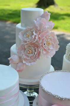Blush And Silver Wedding Cakes With Sugar Peonies Blush and Silver wedding cakes with sugar peonies.