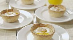 Bacon and Egg Breakfast Tarts - This video shows you how to make impressive bacon-and-egg breakfast tarts. Pastry shells are stuffed with bacon or ham, shredded Cheddar cheese, and eggs, and topped with a sprinkle of ground nutmeg and pepper. The tarts bake just until the eggs are soft-cooked.