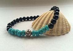 Turquoise Bracelet with Black Onyx and a Silver Bali Bead,  Beaded Bracelet, Yoga Beads, Made in the UK by HarleysJewellery on Etsy