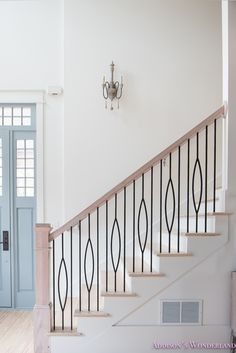 Our Powder Blue Foyer Update! Sharing the progress of our home restoration and my crazy design style. Check out the dramatic wallpaper and fun furniture that we just added to our foyer and living area.
