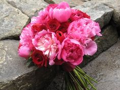 Pink peonies and red rose bouquet.