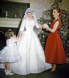 1950's Christmas bride with her bridal party; wearing a beautiful red taffeta dress and FAB shoes!