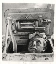1942- New Zealand soldier peers from U.S. tank during a lull in 8th Army fighting in western desert.