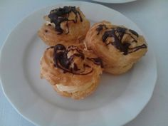 Something czech similar as donuts with a chocotale dip and a vanila puding cream inside,anyway very tasty