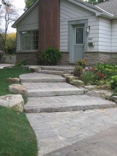 Interlock steps with armour stone border. For front walkway to porch