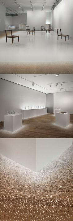 Ghost Stories, New Designs from Nendo at MAD. Illusion of melting plinths by  white, circular stickers around the base.