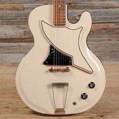 """Summary Body: Two-piece Res-O-Glas body Neck: Maple neck with a Medium """"C"""" profile, 1 11/16"""" wide nut, rosewood fretboard, 12"""" radius, and dot inlays Neck Thickness: .9"""" at the 1st fret, .977"""" at the 12th fret Pickups/Hardware: Grover tuners, one pickup (rated at 9.7 kOhms), volume and tone contr..."""