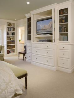 Love this idea. Built ins to hide the TV in the bedroom. Plus the shelving/storage for DVDs etc.  Nobody wants to see that stuff in their bedroom