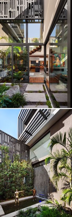 This modern house has a small courtyard with a garden and water feature.