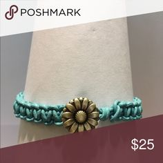 Bracelet Turquoise colored genuine leather macramé bracelet with small sunflower button closure. Measures 8.5 inches. Handcrafted Jewelry Bracelets