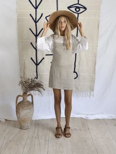 HEIDA DRESS | GREY Slip dress with thin straps in 100% Grey linen Also available in Rust linen Cool machine wash. line dry. cool iron. do not bleach. please use environmentally friendly detergents Measurements for reference - M/L Bust- 35 cm Waist- 38 cm Hips- 45 cm Length- 67 cm S/M Bust- 37 cm Waist- 41 cm Hips- 45 cm Length- 70 cm