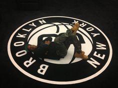 Jay Z Chillin' On A Giant Brooklyn Nets Logo