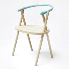 The backrest of this chair by Dutch designers Oato seems to be simply wedged between its criss-crossing legs