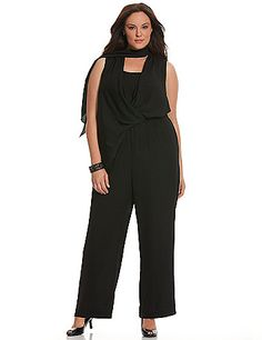 6th & Lane's designer-inspired woven jumpsuit is truly a 10 with flirty, draped paneling for extra drama and sweeping wide leg silhouette. Lined surplice neckline and elastic banded waist keep the fit tailored.  An attached scarf and buttoned keyhole back complete the look. lanebryant.com