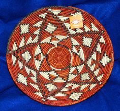 """A colorful finely woven basket. 14"""" diameter 2.75"""" depth. Great for fruit or party snacks, but SO pretty you may just want to hang it on your wall as an accent piece! $24.95 #baskets #southwestern #handwoven #homedecor"""