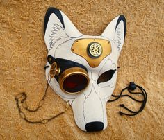 """Over the holiday, I had time to work on a lovely white/gold steampunk wolf mask. """"All The Better To See You With"""" is available now in my Etsy shop. Remember, Mardi Gras will be here sooner than you... merimask"""