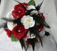 Wedding bouquet set red and white roses black feathers crystal gems bridal bouquets and boutonnieres. $157.00, via Etsy.