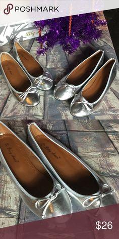 DEAL Silver metallic ballerina flats NIB var sizes Silver metallic ballerina flats NIB. Various sizes. Lily Shoes Shoes Flats & Loafers