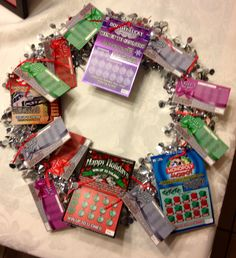 Lottery Ticket Wreath. Great gift idea! Choose a pretty wreath, ribbon, hole puncher, and scratch offs. Simply add the tickets to the wreath. Just be sure not to hole punch the barcode of any of the scratch offs. Don't want to jeopardize the validity of any winning tickets! You could 'theme' your creations by whatever scratch off you choose (Christmas, birthdays, St. Patrick's day...)Happy creating! ;-)