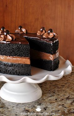 Midnight Sin Chocolate Cake -  a rich, moist chocolate cake. A simple, reliable chocolate cake recipe for folks who love their cakes uber-moist-a-licious.  filling it with bitter-sweet chocolate mousse and glazing it with ganache.