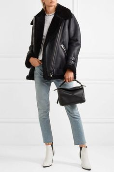 Black shearling, midnight-blue leather Asymmetric zip fastening through front 100% shearling (Lamb); trim: 100% leather (Lamb, Calf) Specialist clean Imported