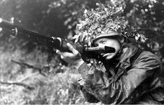 A German Fallschirmjäger poses with his FG 42 battle rifle during the battle for Caen, June 1944.
