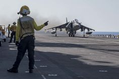 MEDITERRANEAN SEA (Aug. 18, 2016) An AV-8B Harrier, from the 22nd Marine Expeditionary Unit (MEU), takes off from the flight deck of the amphibious assault ship USS Wasp (LHD 1). The 22nd MEU, embarked on Wasp, is conducting precision air strikes in support of the Libyan Government of National Accord-aligned forces against Daesh targets in Sirte, Libya, as part of Operation Odyssey Lightning. (U.S. Navy photo by Mass Communication Specialist 3rd Class Zhiwei Tan/Released) Us Navy Ships, Mass Communication, Flight Deck, Mediterranean Sea, Aircraft Carrier, Coast Guard, Marine Corps, Military Aircraft, Past