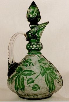 Green cut to clear crystal glass liqueur decanter with acid etched decorations and matching steeple stopper engraved in a poinsettia floral motif, poss. by Dorflinger Crystal Decanter, Crystal Glassware, Wine Decanter, Cut Glass, Glass Art, Clear Glass, Clear Crystal, Antique Glass, Antique Art