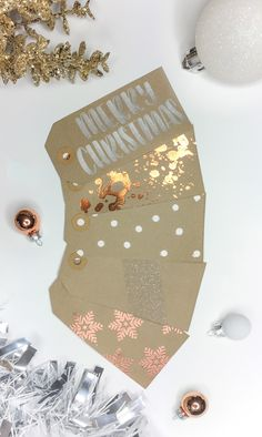 DIY Christmas gift tag ideas you can do at home. Silver brush lettering. Gold or copper foiled splatters. White polka dots. White glitter stripe. Copper powder embossed snowflakes. Kraft brown gift tags.