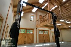 and here it is, in a garage with a lift!Real Carriage Doors - Closeup this is way I am talking about I want Garage Attic, Barn Garage, Garage House, Garage Shop, Garage Plans, Garage Workshop, Dream Garage, Attic Lift, Cool Garages