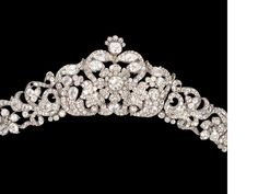 A diamond tiara, circa 1840 | Designed as an articulated wreath of highly stylised blooms amongst meandering foliate motifs, set throughout with cushion-shaped, pear-shaped and old brilliant-cut diamonds, mounted in silver and gold, diamonds approximately 50.00 carats total, seven smaller diamonds deficient, detachable from frame and may be worn as a necklace, centrepiece may be detached and worn as a brooch