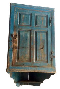 "Hanging corner cupboard - 18th c. Original blue paint. Paneled doors. Appropriate wear. Found in Virginia. 30"" wide by 52"" tall. Takes 22"" corner. Offered 6/7/16 on 1stNLine for $6,500 by Libby Wojcik."