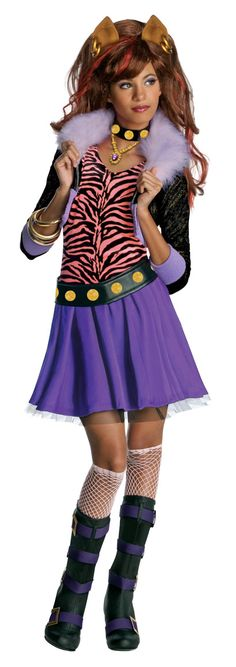 Clawdeen Wolf Monster High Costume - This is a Clawdeen Wolf costume from Monster High. This is a four-piece costume with a jacket with attached shirt, skirt, belt and collar. The jacket is a cropped bomber jacket with faux fur trim for the collar and like purple trim on the cuffs and bottom of the jacket. The attached shirt is tiger print with a ruffle collar. #clawdeen #yyc #monsterhigh #calgary #costume #tv #movie #kids #children #teen