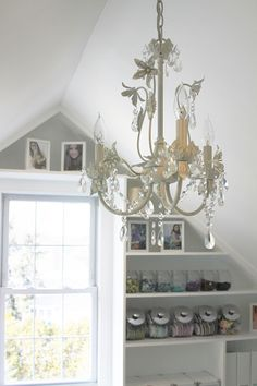 Paint Chandelier white and add crystals. . or buy a new one. . decisions.