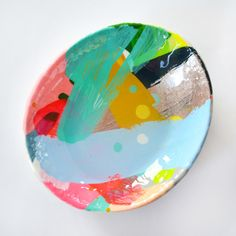 These unique hand painted ceramics are made from quality high fired stoneware and finished with a gloss apoxy resin. Each of these is a unique artwork in its own right, painted by renowned abstract artist Rowena Martinich. These dishes are decorative objects rather than intended for food. Hand made in Melbourne.Dishes are approximately 9cm in diameter, stamped with Martinich
