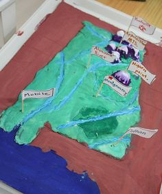 Salt dough map with flags. The picture is of a map of Alabama but it can work for any country, state or continent. Very hand-on, great idea for tactile learners!