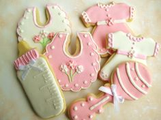 Girl Baby Shower Cookies - Shower cookies for baby girl.  I thought it was a cute idea when the customer requested the little dress.  I'd never thought of that for a shower.