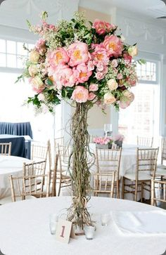 A twig stem centrepiece with relaxed floral dome. Not focusing on colour.