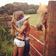 OH MY GOSH THIS IS SO CUTE. I MEAN.... DO YOU SEE THAT BEAUTIFUL HORSE? Oh. The couple is cute too... I guess.