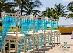 Coral blue accents and palm trees in the background make the perfect setting for your destination wedding at Now Jade Riviera Cancun!