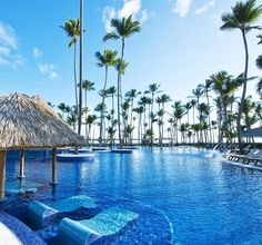 Barcelo Bavaro Beach Adults Only All Inclusive: This beachfront all-inclusive Adults Only resort features an outdoor swimming pool surrounded by coconut trees and sun loungers.
