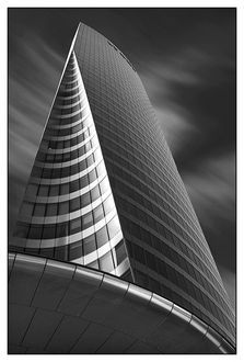 Black and White Photo of a Building; the left side could be a witches hat