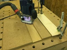 Routing The MDF base for inserts on the drill press table.