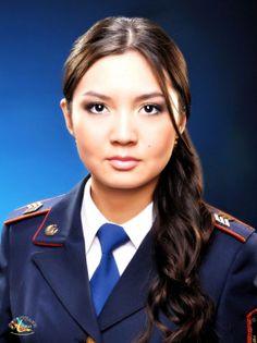 Karlygash Yegimbayeva, winner of Kazakhstan Police Woman - 2011. Police sergeant Karlygash Yegimbayeva, Winner of most beautiful police woman, Kazakhstan; also judo champion and belly dancer.