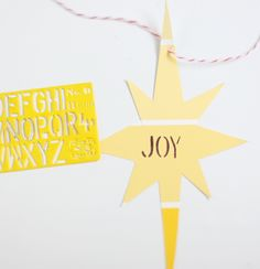 Paint Chip Ornaments from @Liz Stanley - such a huge idea! Woulkd be great for gift tags too.  #diy #craft