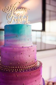 Stunning purple, pink, teal, and blue wedding cake!