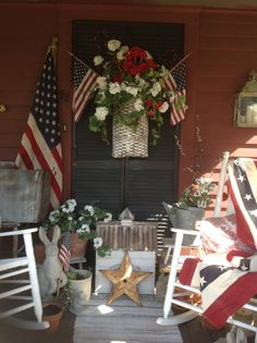 Come sit a spell...mainstreetoriginals.com  Love this patriotic or 4th of July porch design with blue shutter, red, white  blue flowers, quilt, flags, etc.