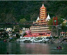 A Mesmerizing View of Temple & Laxman Jhula, Rishikesh, Incredible India, Tower Bridge, Temples, Tourism, The Incredibles, City, Places, Travel